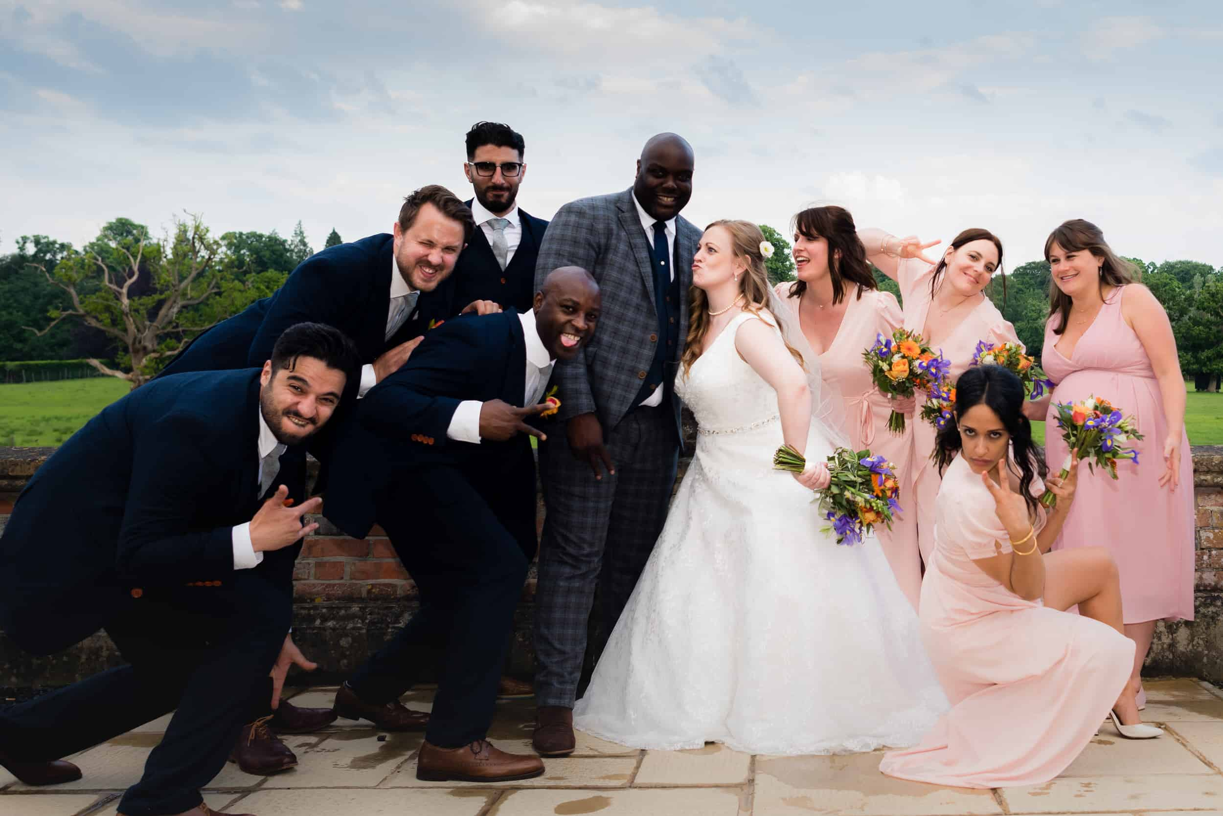 wedding at Burley manor hotel and spa in the new forest. having fun, laughing and relaxed photography
