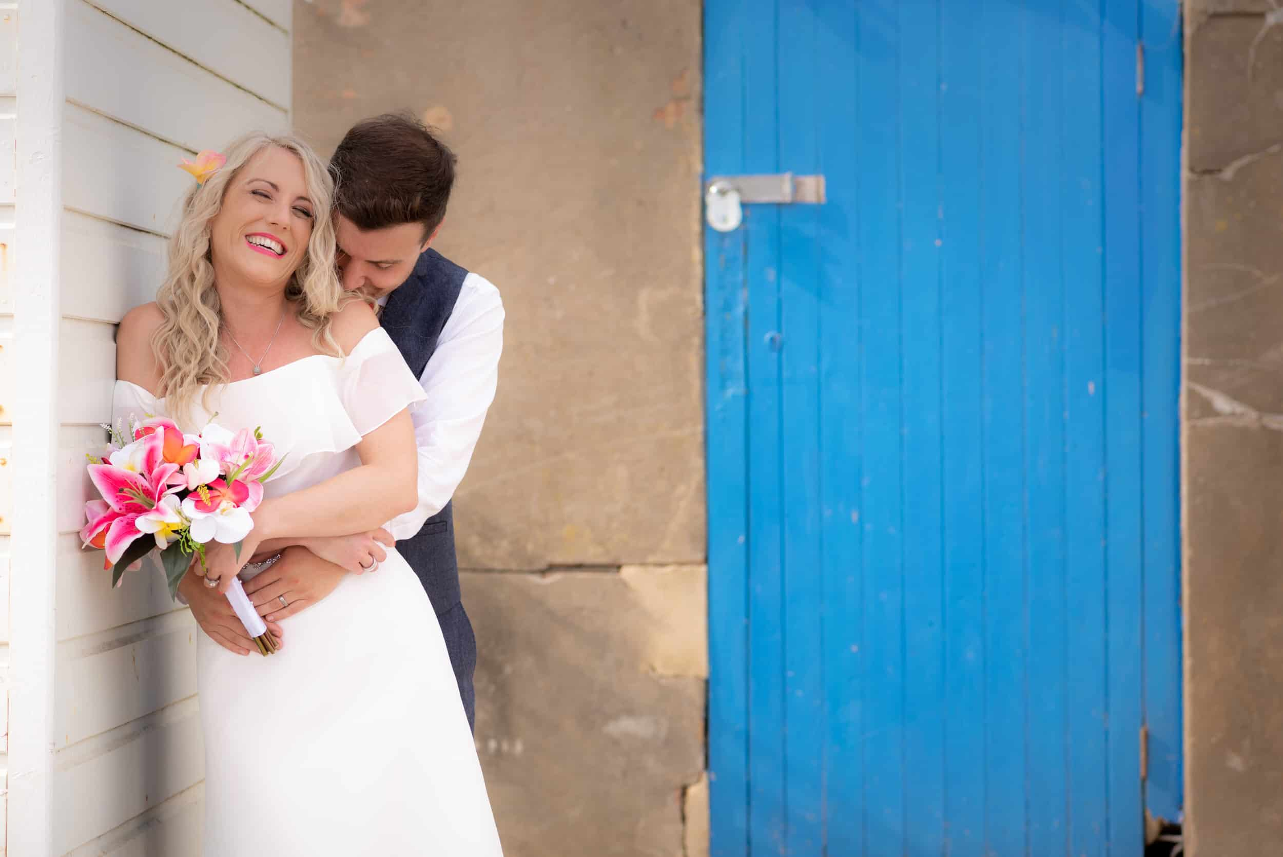 Portrait of bride and groom with beautiful colours and sky photo at Hawk Conservancy in Andover on their wedding day