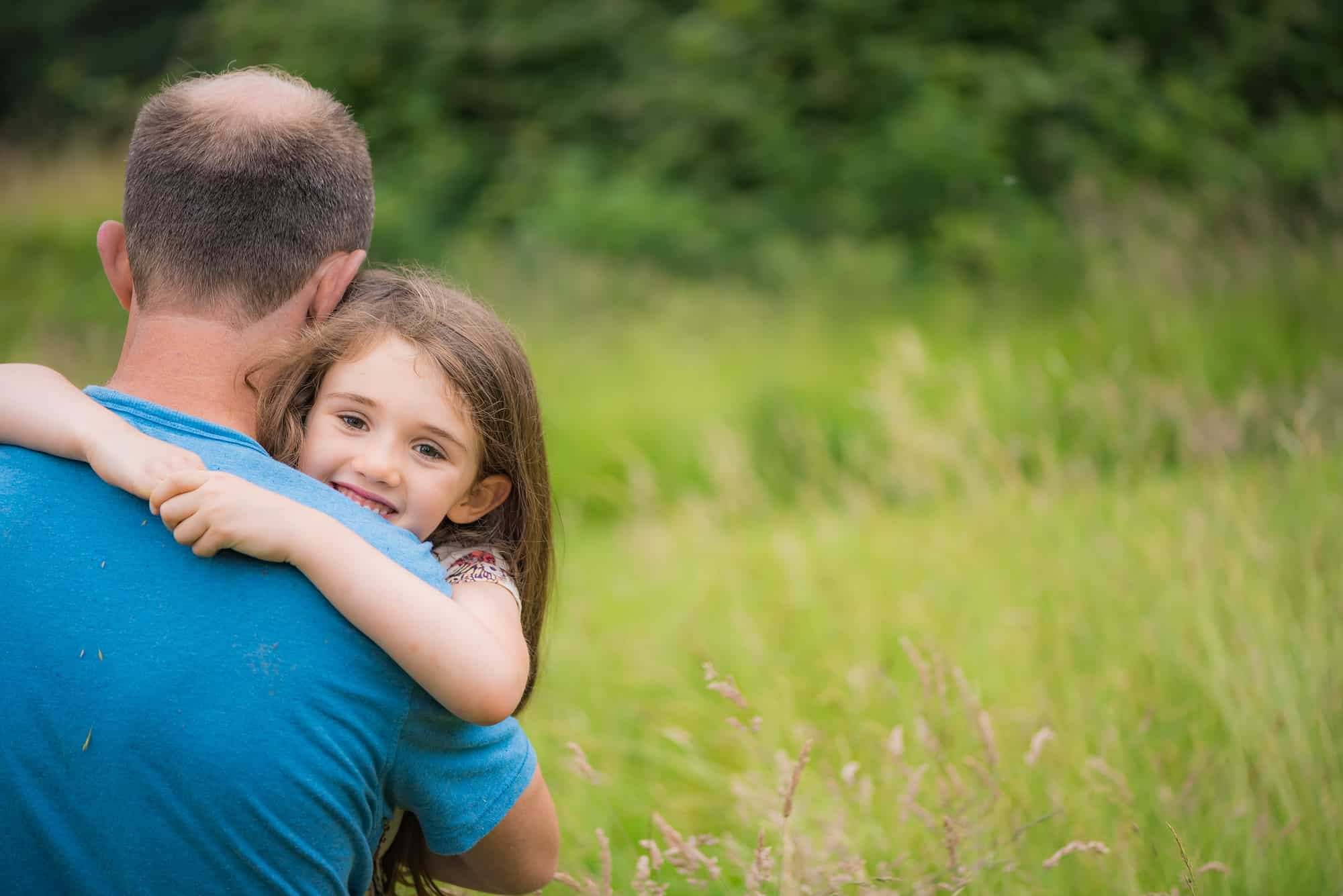Father & daughter having fun and cuddling together on their outdoor photo session in Eastleigh