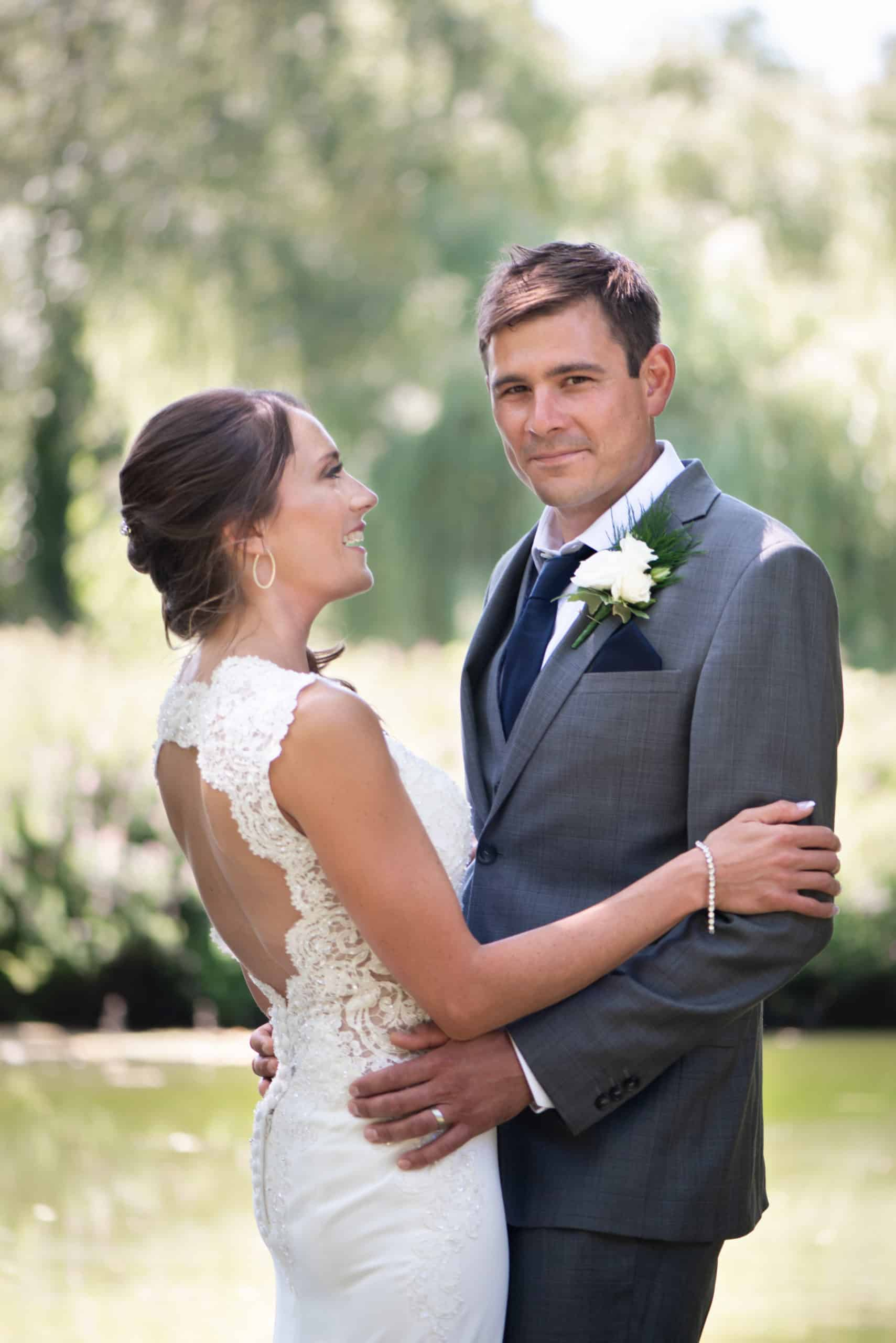 couple shots of bride and groom, concentrating on the groom and stood by the lake at Botleigh grange hotel and spa in Southampton