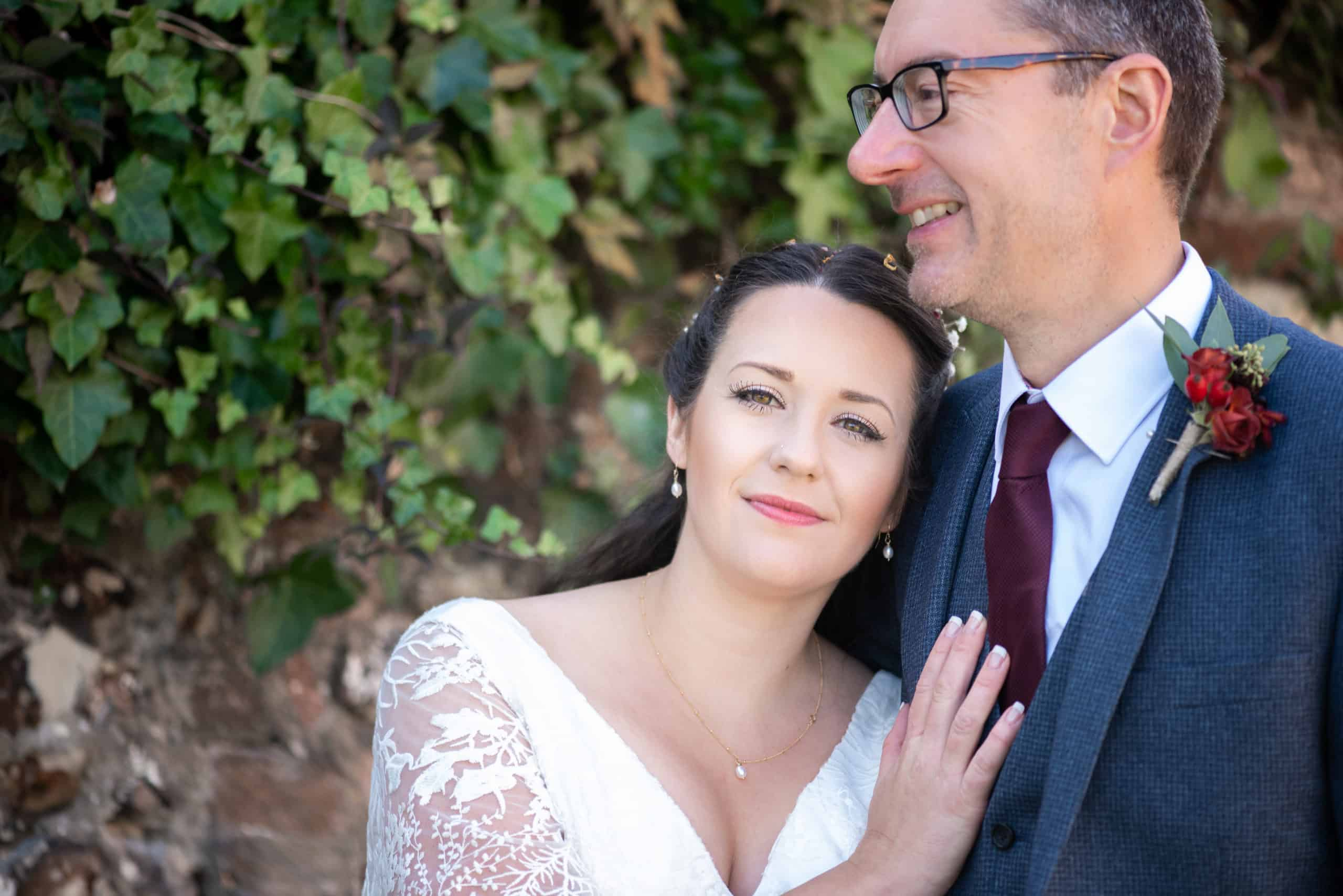 Bride and groom cuddles together on their wedding day in Salisbury hampshire