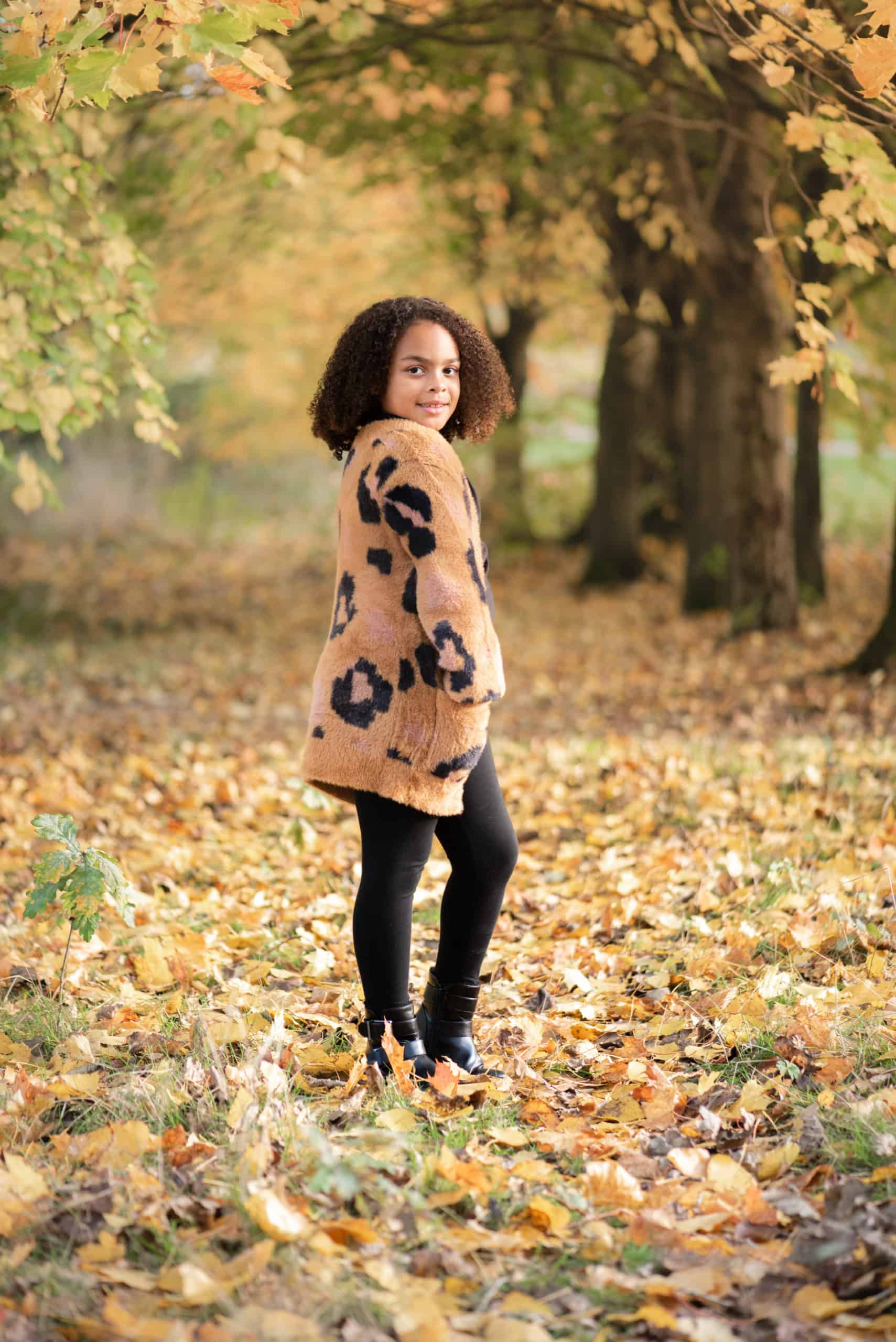 Beautiful daughter posing for some childrens portraits at Fleming Park, eastleigh, Hampshire. Autumnal theme photos with orange colours for these family photos