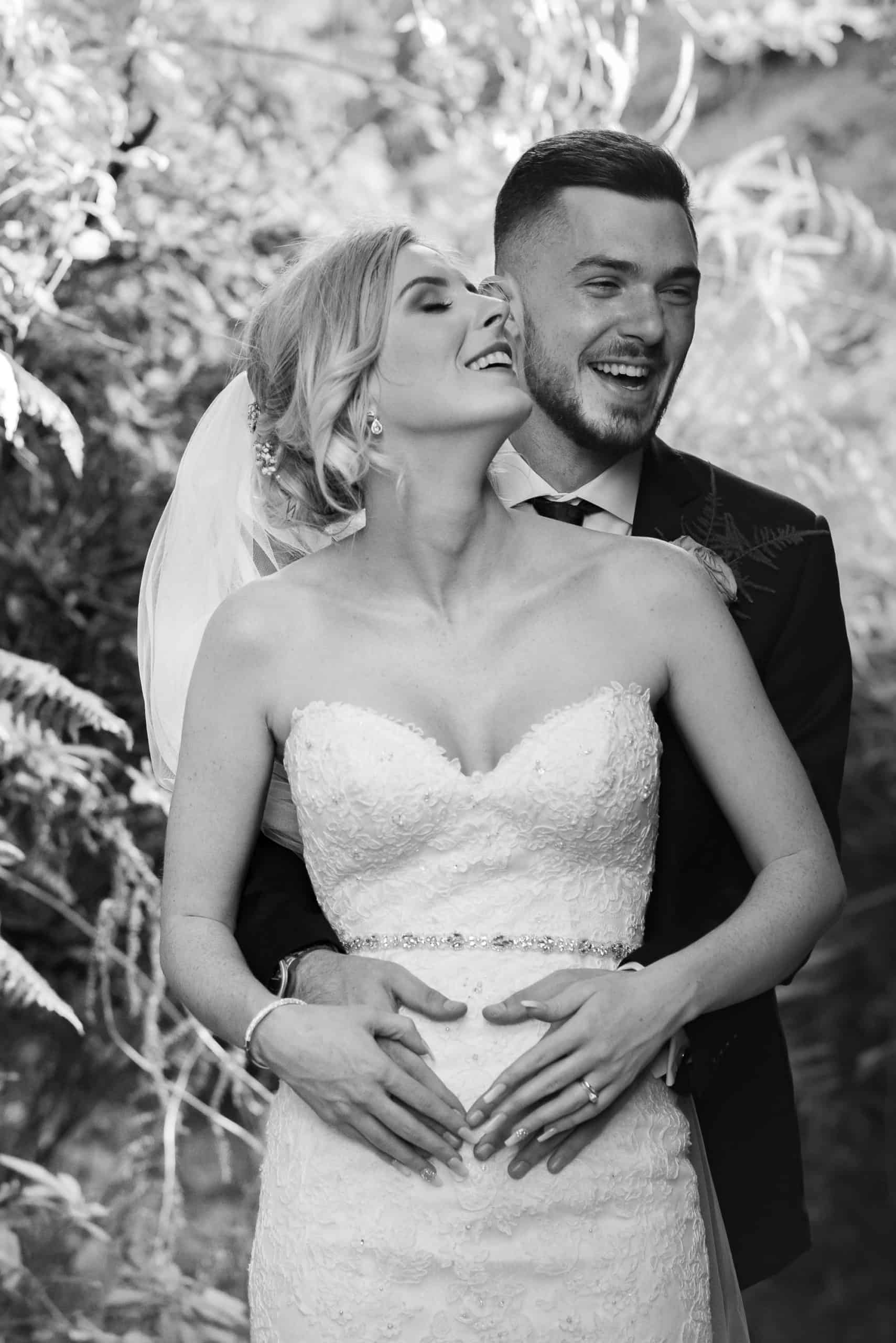 Bride and groom arm in arm having fun. black and white photo